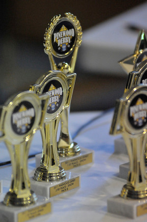 "Walt Hester | Trail Gazette<br /> Pinewood Derby trophies await claimimg at the annual event on Saturday. Winners and several place were recognized in each group, as well as an ""open"" division."
