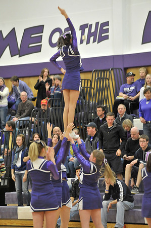 Walt Hester | Trail Gazette<br /> Estes Park High School cheerleaders perform for the home crowd at Friday's Bobcats basketball game. After some years off, the squad is attempting stunts for the entertainment of the croud.
