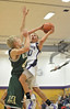 Walt Hester | Trail Gazette<br /> Andrew Cirone puts up two of his 13 points over Kyle Stuehm of Highland High School on Friday. Three Bobcats scored in double figures against the Huskies.