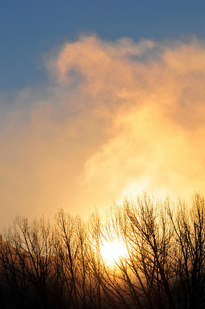Walt Hester | Trail Gazette<br /> The sun pierces fog created by Lake Estes on Wednesday morning. The open water on Lake Estes was between 50 and 60 degress warmer than the air above it, causing the morning mist.