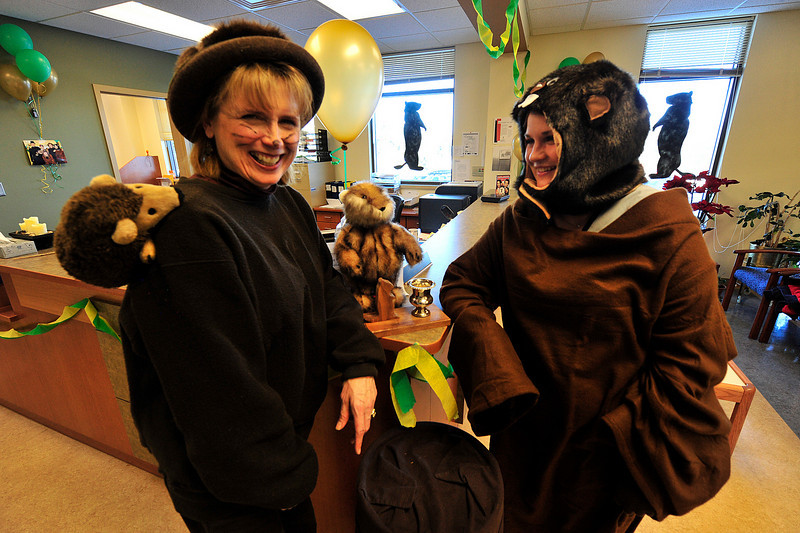 Walt Hester | Trail Gazette<br /> Kathy Giesige, left,  and Margaret Evens have a little Ground Hog Day fun at the Estes Park Medical Center on Wednesday. The famous Pennsylvanian prognosticator predicted an early spring.