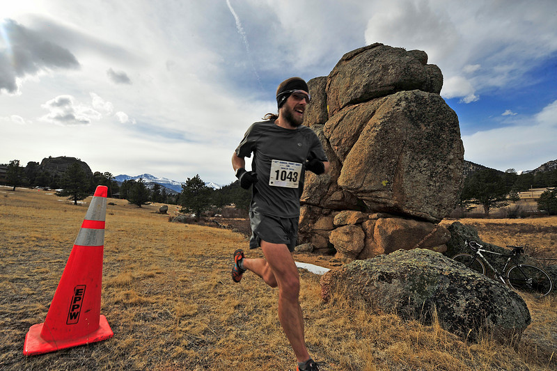 Walt Hester | Trail Gazette<br /> Nick Clark of Fort Collins storms through the 10K course on his way to the men's overall victory in Sunday's Frost Giant. Clark, a fourth-place finisher of the Western States 100 ultra-marathon, also won the Frost Giant 5K.