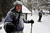 Walt Hester | Trail Gazette<br /> New snow decorates trees and snowhoer Jim Rogers of Salina, Kan. at the Emerald Lake Trailhead on Monday. Much of Rocky Mountain National Park is reporting snowpack well above the 30-year average.