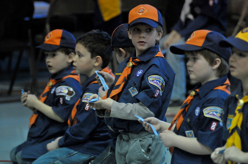 Walt Hester | Trail Gazette<br /> Scouts check their tickets to win goodies at the Pinewood Derby. The scouts won carmel corn and cake.