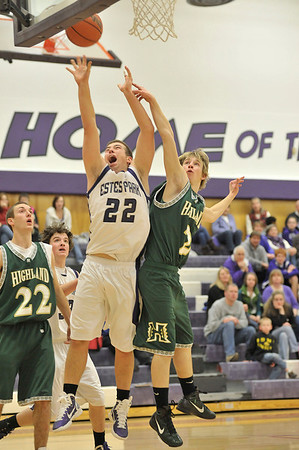 Walt Hester | Trail Gazette<br /> Zach Eitzen scores two of his team-leading 17 points against Highland on Friday. Three Bobcats scored double figures in an exciting game.