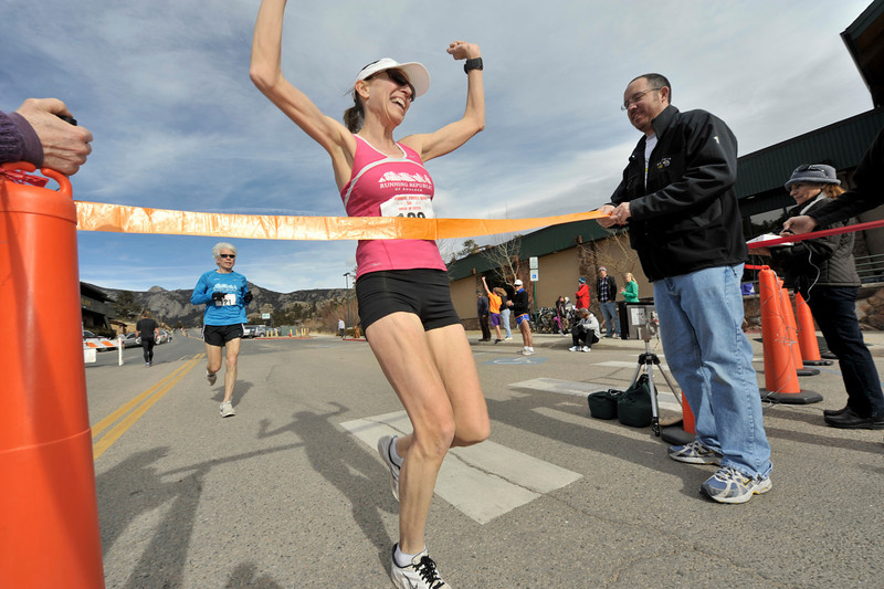 Walt Hester   Trail Gazette<br /> Laura Bruess of Boulder wins the women's 5K of the annual Frost Giant on Sunday. Times were generally fast, as temperatures were in the high 40's for most of the race.