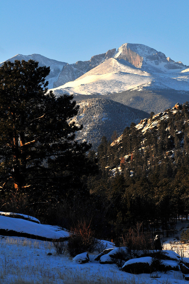 Walt Hester | Trail Gazette<br /> Wednesday morning's light reflects off of the snow on Longs Peak.