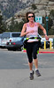 "Walt Hester | Trail Gazette<br /> Estes Park runner Lisa Marshall grins as she approaches her first-place finish of the Frost Giant 10K on Sunday. ""It took me 20 tries,"" said Marshall of her victory."