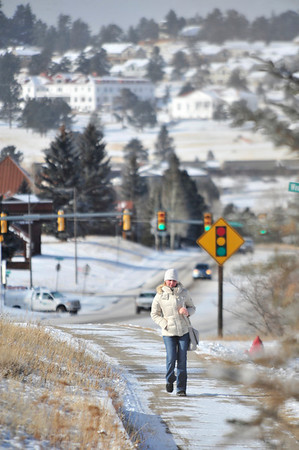 Walt Hester | Trail Gazette<br /> Alena Trofimora of Estes Park seems unfazed by the below-zero temperatures as she walks along South St. Vrain Avenue on Tuesday. Highs on Tuesday registered no higher than -3, while lows dipped as low as -20.