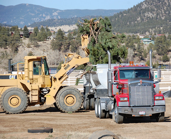 A frontend loader loads debris onto a truck Monday as work on the transportation hub started March 21 at the Fairgrounds at Stanley Park.