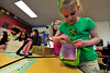 Walt Hester | Trail Gazette<br /> Lexi Lerew, 7, sets the trigger of her leprechaun trap at the Estes Park Elementary School on Thursday. The first-graders made the traps for the tiny, mythical Irish trouble-makers, then showed and explained the divices to preschoolers.