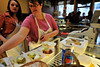 Walt Hester | Trail Gazette<br /> Tricia Vick, 15, and Val Thompson hurriedly prepare their sampler as visitors pile in to the Estes Park Pie Shop. Based on observation, Savor Estes has becaume very popular, packing many of the participating restaurants.