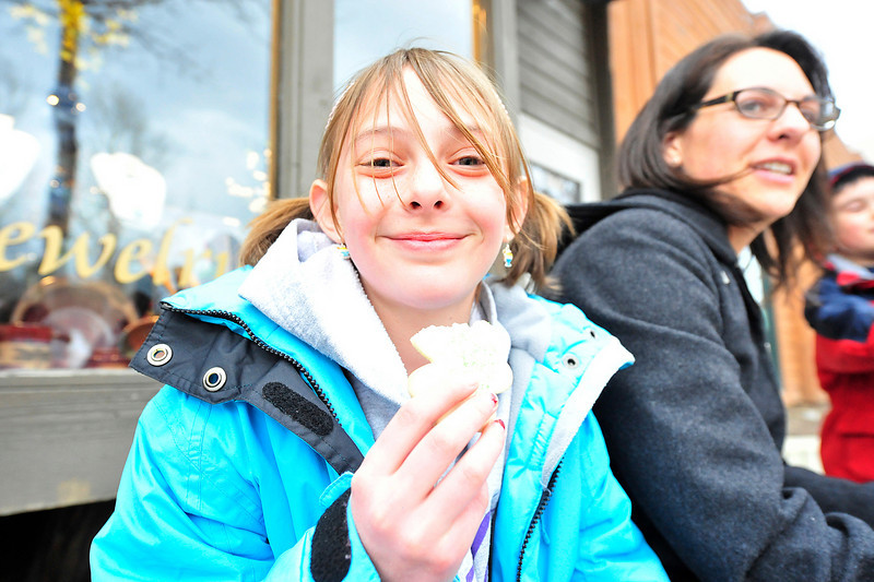 Walt Hester | Trail Gazette<br /> Mae Tice, 9, of Estes Park enjoys a sugar cookie along Elkhorn Avenue. Each of the 27 participating restaurants shows off a sample of their quisine for only $3.