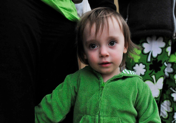 Walt Hester | Trail Gazette<br /> Lily Benjamin, 2, wears her holiday green along Elkhorn Avenue on St. Patrick's Day. Thursday was the annual celebration of the patron saint of Ireland, the cleric credited with explaining the Holy Trinity with a three-leaf clover.