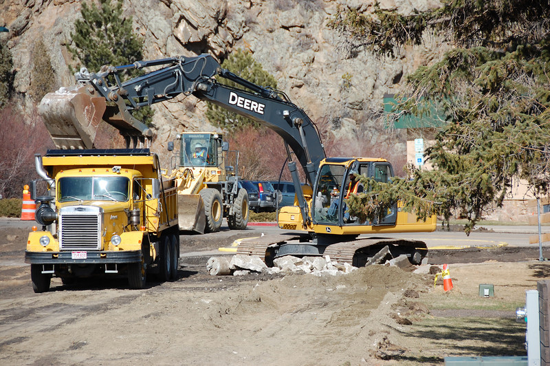 Heavy equipment removes concrete, asphalt and other debris Monday as the Bond Park renovation project began on March 21.