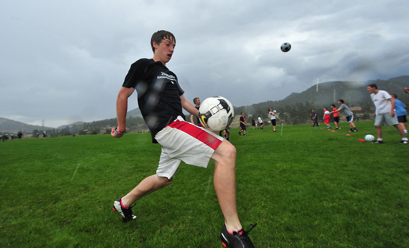 Zach Pierce controls a ball during a rain-soaked pratice on Monday. Autumnal rain and cool temperatures are expected throughout the week in Estes Park