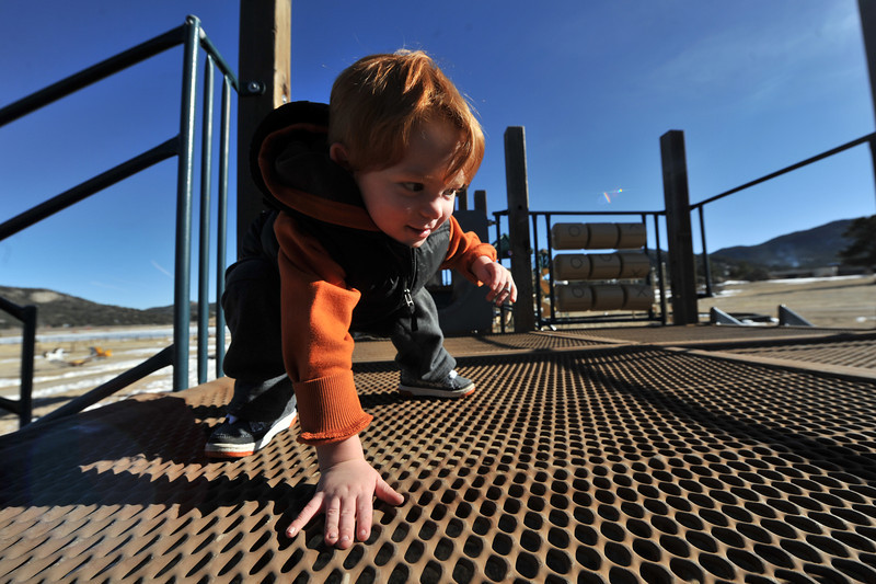 Rocco Faillaci, 2, plays on equipment at the Stanley Park Playground on Wednesday. Chioldren and parents alike could not pass up the warmth and sunshine on Wednesday.