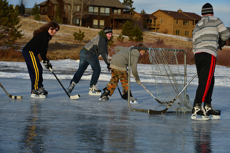 Winter sports enthusiasts get out on the Scott Ponds for pond hockey on Sunday. After an autumn temperatures well above normal, January temperatures have frozen water all over the Estes Park area.