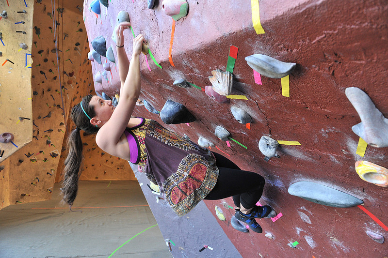 Gracia Alger of Minneapolis, Minn., works her way up the bouldering area of the Estes Park Mountain Shop's climbing wall on Monday. While not as abundent, indoor oppertunities can be found around Estes Park.