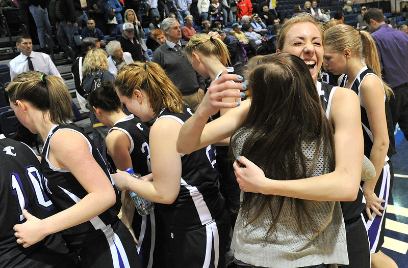 Estes Park's Amanda Dill shares a hug with a friend in celebration of the Ladycats' fifth place finish in the Patriot League tournament on Friday. The girls defeated Brush 45-38 to earn a slot in the girls' 3A state playoffs.