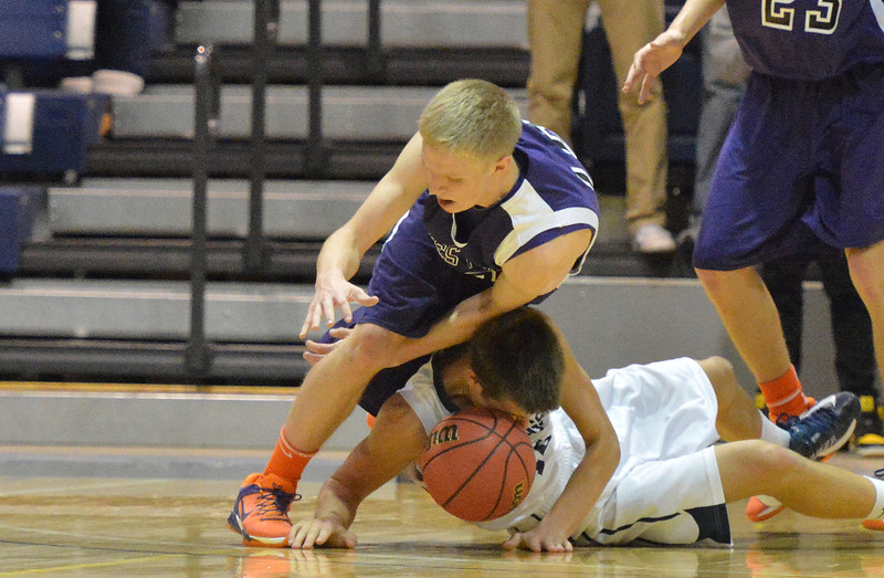 Estes Park's Taylor Marshall trips over University's Tanner Sparks during Friday's Patriot League playoff game. The 'Cats also stumbled, taking a 19-point loss, though also taking the fourth seed out of the league into this week's state playoffs.