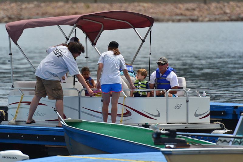 The Lake Estes Marina staff helps dock a pontoon boat on Thrusday.