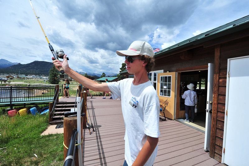 Marina staff member Brian Wenzel tests the fishing equipment at the Lake Estes Marina on Thursday.