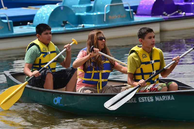 A family takes a canoe out onto Lake Estes on Thursday.
