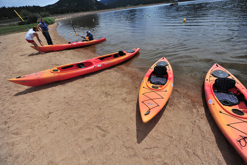 One or two-person kayaks sit in the sand at the marina. The watercraft are a great way to share the day or get some exercise on the lake.