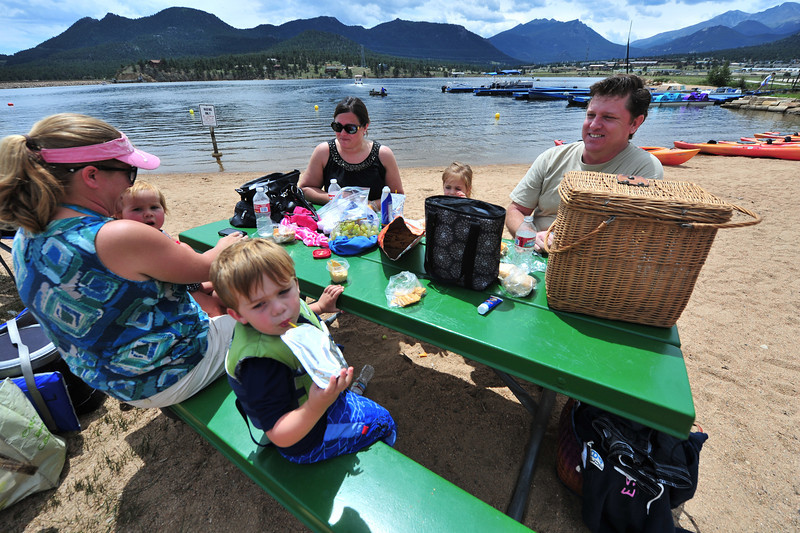"Missy Ferguson with children Camille, 1, and Tyler, 3, all from Long Beach Calif., enjoy a lakeside lunch with friends Lisa, Ruby ""Foxy"", 3, and Josh Jenson, of Omaha. The tables at the arena make a good place for a post-lake lunch."