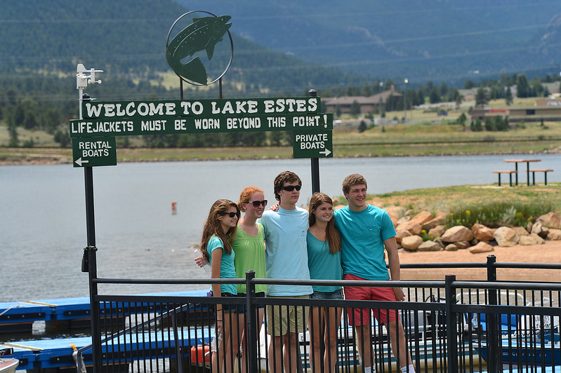 Teens creat memories at the sign at Lake Estes Marina on Thursday.