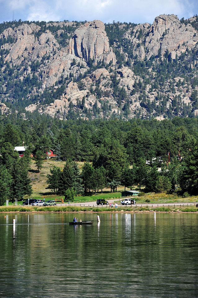A family cruises under the Twin Owls on Lake Estes on Wednesday. Warm temperatures are causing outdoor enthusiasts to take every opportunity to get out.