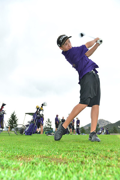 Senior Brian Coleman takes swings at the 18-hole public course on Wednesday. Coleman and fellow senior Dylan Jirsa tied for fourth at the state golf tournament last season.