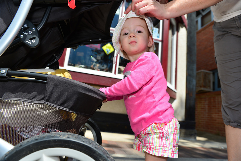 Marilyn Lasher, 18 mo., of Longmont helps push her stroller down Elkhorn Avenue on Wednesday. Warm weather hill likely persist through the weekend, with highs in the 80s, making outside activities pleasant.