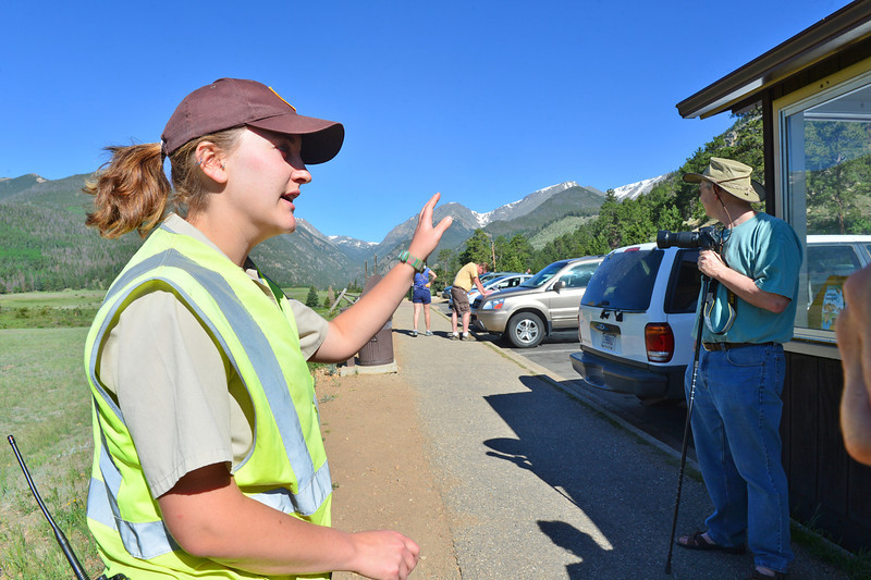Laurana Snyder of the national park's Bighorn Brigade explains the scars left by the Lawn Lake Flood to visitors at the Sheep Lakes on Thursday. The volunteers know about more than bighorns, as they are usually able to answer a grat range of questions concerning the national park.