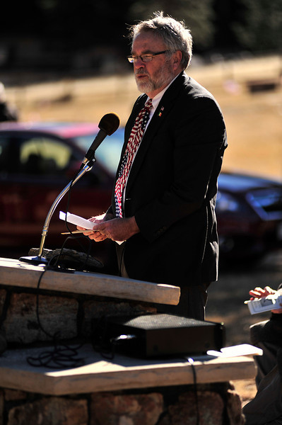 Estes Park town administrator Frank Lancaster addresses Monday's Veterans Day service at the Estes Valley Memorial Gardens. Lancaster pointed out the contributions of veterans to the rebuilding of US 36, many of whome had toured in both Iraq and Afghanistan.