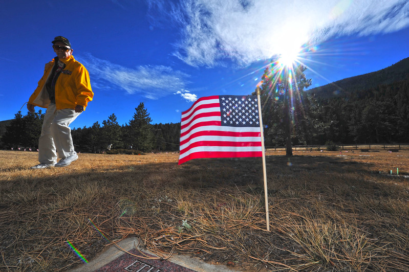 Jack McDade of Estes Park strolls among the flags and headstones in the Estes Valley Memorial Gardens on Monday. The WWII veteran was at the gardens for the annual Veterans Day Ceremony