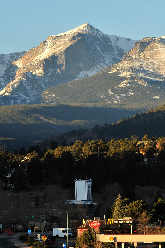 Hallett Peak towers over the Park Theater and downtown Estes Park on Monday. The the weekend may turn cooler with snow possible on Sunday.
