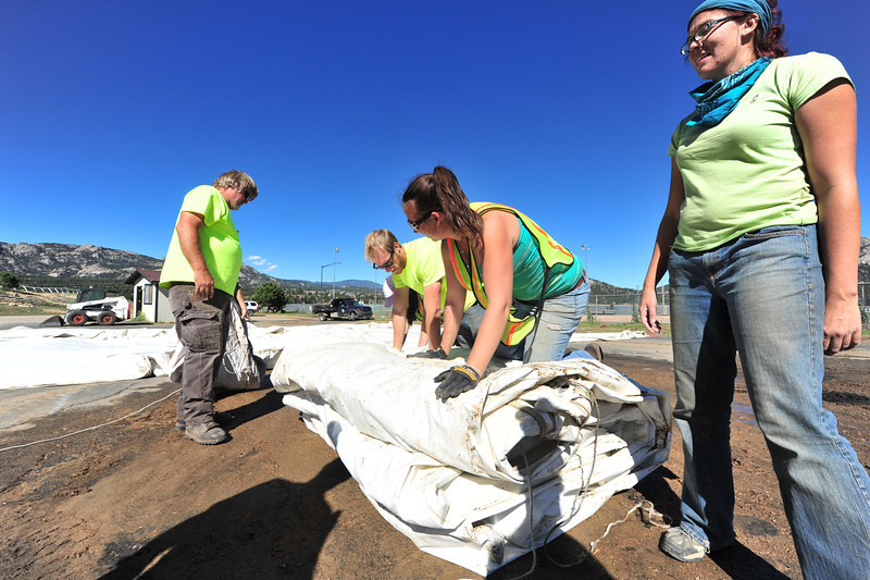 Estes Park's public works and special events workers fivally pack up the tents from ScotFest on Wednesday. The flooding of Sept. 12-13 set many projets back as priorities changed.