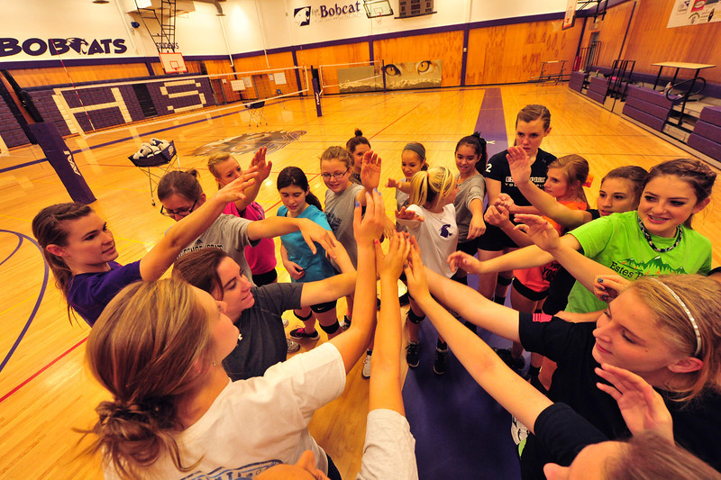 The Ladycats' volleyball team demonstrates unity during Wednesday's practice. Estes Park's isolation from the floods has caused problems in the remainder of the fall schedule.