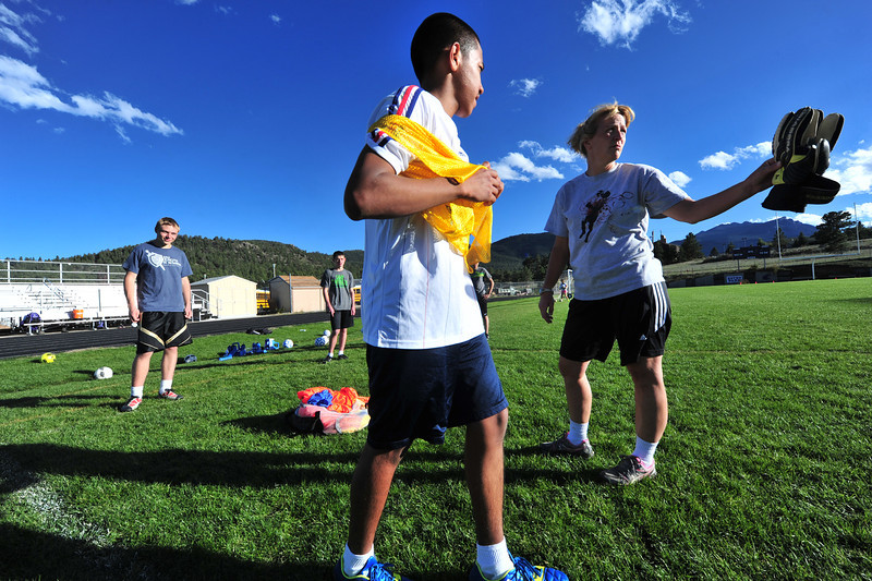 Soccer coach Kay Hays points Erick Dominguez in the right direction on Wednesday. Hay and the team are trying to cobble together a schedule that still gives them the chance to make the post-season bracket.