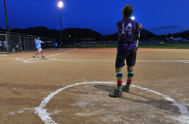A teammate watches as Dr. Mark McElwee smacks a triple into the outfield during the Life Savers of the Estes Park Medical Center softball game against the Brew Crew from the Estes Park Brewery on Wednesday night. While This was the last regular week for the slow-pitch co-ed league, there is another week left for the open league and three tournaments left before the end of summer.