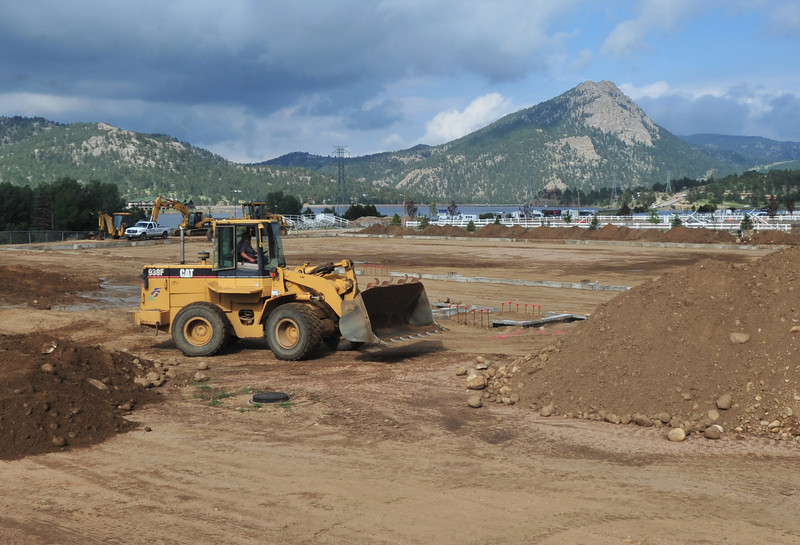 Construction workers continue work on the event center, slowly taking shape at the Stanley Fairgrounds on Monday.