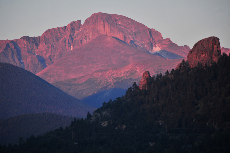 The first rays of morning stain Longs Peak a sodt red on Wednesday morning. The first tdays light on the mountains is refered to as alpinglow.