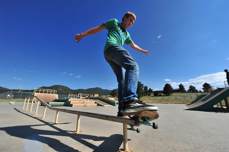 Nick Taylor, 15, of Arvada, rides a rail in the Estes Valley Skate Park on Wednesday. the park is equally popular among visitors and locals during the long, hot days of summer.