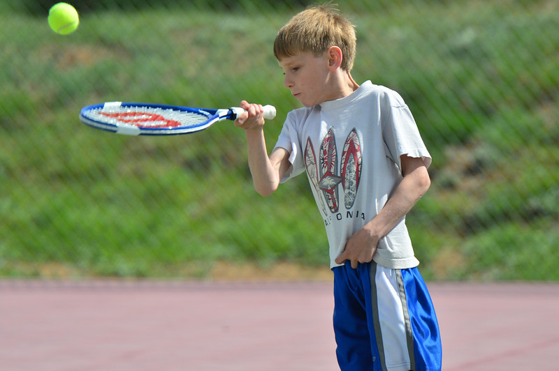 Sasha Richmond, 8, of Estes Park works on his forehand at the Stanley Park tennis courts on Tuesday. With warmer weather, the courts will start to fill early.