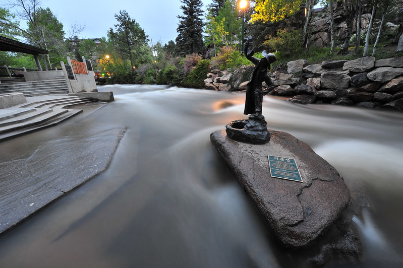 The Fall River climb steps in Tregent Park as the river rushes toward downtown Estes Park on Wednesday. As temperatures rise, April and May precipitation melts off and rushes through town.