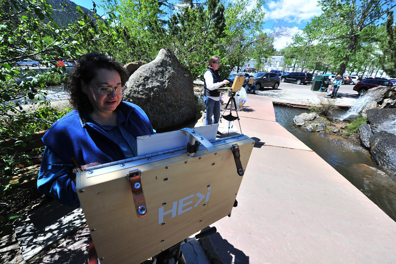 Roachelle Retime, Kelly Kotary and several more Plein Air painters work in Riverside Plaza on Wednesday. The group meets and paints in a different location every Wednesday.
