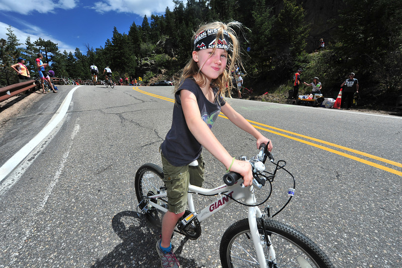 A young rider smiles as she descends the switchbacks on Saturday.