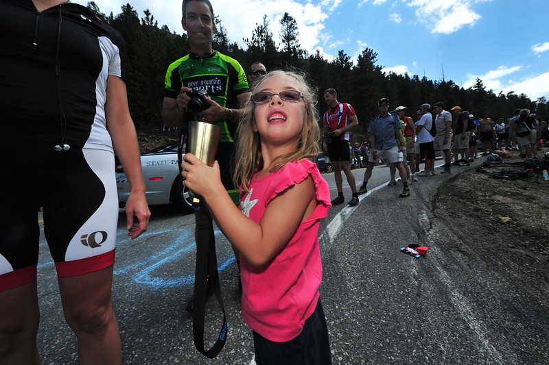 A young fan answers the call for more cowbell.